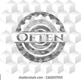 Often grey badge with geometric cube white background