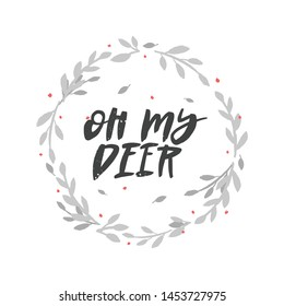 Oh my deer brush lettering in floral wreath. Handwritten Christmas typography print for flyer, poster, card, banner. Hand drawn decorative design element.