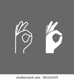 OK hand sign on a light background