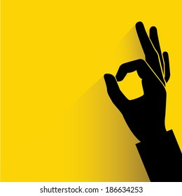 okay hand sign yellow background