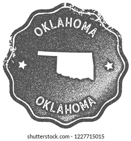 Oklahoma map vintage stamp. Retro style handmade label, badge or element for travel souvenirs. Grey rubber stamp with us state map silhouette. Vector illustration.