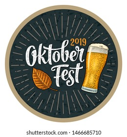 OktoberFest 2019 calligraphic handwriting lettering with rays. Glass beer and leaf. Vector vintage engraving illustration on dark background. Advertising design for poster and coaster.