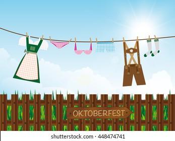 oktoberfest background outdoors, lederhosen, dirndl, panties, lingerie, socks hanging on clothes line, destination board on wooden garden fence,