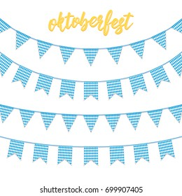Oktoberfest decorations. Buntings for Oktoberfest. Garland buntings of Bavarian checkered blue flag, and hand lettering Oktoberfest logo.