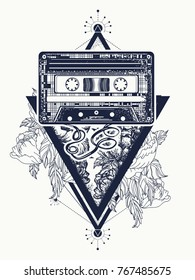 Old audio cassette and roses flowers, symbol of pop music, disco. Symbol of retro music, nostalgia, 80th and 90th