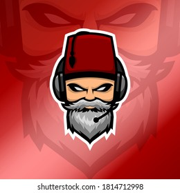 Old beard man esport logo with headset and red fez hat in glossy red gradient background. White beard man logo. Suitable for gaming squad or clan logo