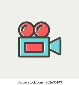 Old cinema video cam icon thin line for web and mobile, modern minimalistic flat design. Vector icon with dark grey outline and offset colour on light grey background.