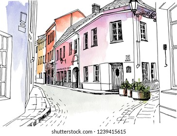Old city street in hand drawn line sketch style. Urban romantic landscape. Vilnius. Lithuania. Black and white vector illustration on watercolor background