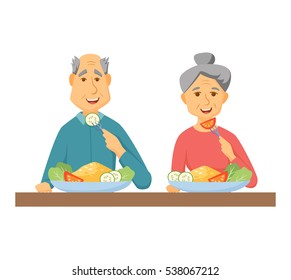Old coupe eating healthy food. Lifestyle concept. Smile people eat at home together. Elderly man and women in having breakfast