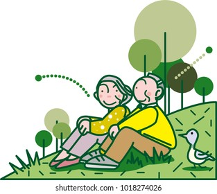 Old couple sitting on grass