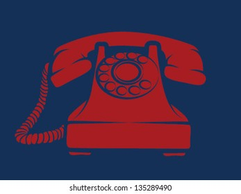 Old fashioned red phone on navy background