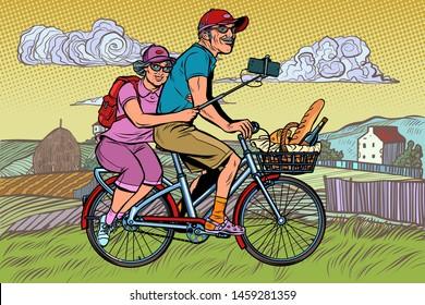 old man and old lady travelers on bike, selfie on smartphone. Pop art retro vector illustration vintage kitsch
