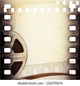 Old motion picture film reel with film strip. Vintage vector background