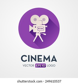 Old movie camera with reel. Flat design icon, logo. Symbol of the film production industry.