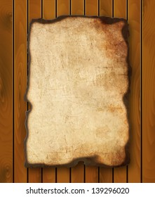 Old  paper with burnt edges isolated on a wooden background. Vector  eps10