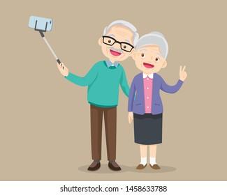 Old people selfie. Senior people smiley face smartphone photo.Elderly couple making selfie.Modern senior couple.