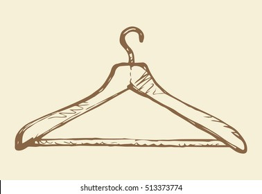 Old plastic hanger for shirt, dress, coat, isolated on white backdrop. Freehand outline black ink hand drawn picture sketchy in art retro scribble style pen on paper. View closeup with space for text