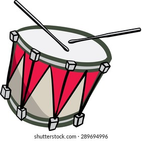 Old red and white drum with drum sticks playing