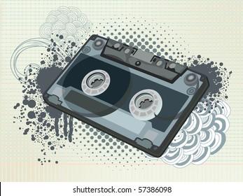 old retro audio tape on bizarre doodle background