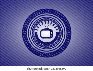 old tv, television icon inside badge with jean texture
