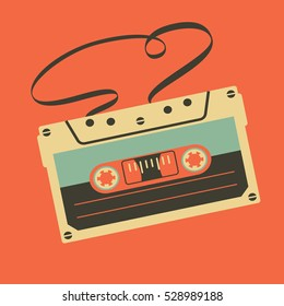 Old vintage audio cassette with tangled tape on orange background