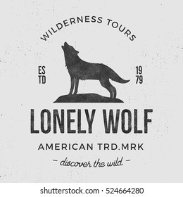 Old wilderness label with wolf and typography elements. Vintage style howling wolf logo. Graphic print design for t-shirts, mugs etc.Hand drawn insignia, rustic design. Vector Letterpress effect.