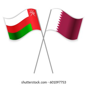 Omani and Qatari crossed flags. Oman combined with Qatar isolated on white. Language learning, international business or travel concept.