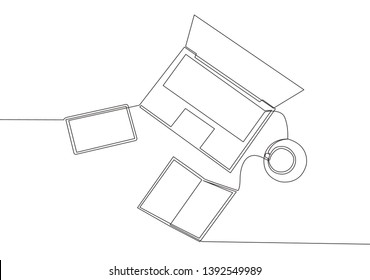 One continuous line drawing of and computer laptop, smartphone, tablet and book a cup of coffee at business office desk from top view. Work space table concept. Single line draw design illustration