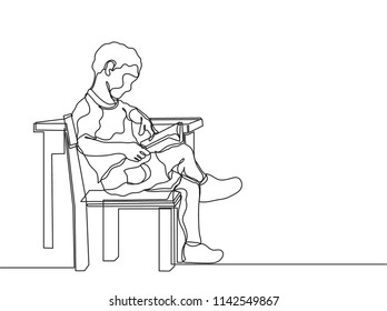 One continuous line drawing of happy kid boy read a book while sitting on chair beside the desk. Single line education concept vector illustration
