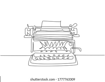 One continuous line drawing of retro old vintage typewriter front from view. Classic office item concept single line draw design vector graphic illustration