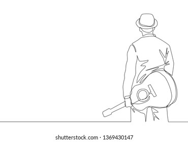 One continuous line drawing of young happy male guitarist wearing hat and holding acoustic guitar on his hand. Musician artist concept single line draw design illustration