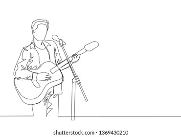 One continuous line drawing of young happy male guitarist playing acoustic guitar and singing on music festival stage. Musician artist performance concept single line draw design illustration
