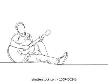 One continuous line drawing of young happy male guitarist sitting relax on the floor while playing acoustic guitar. Musician artist performance concept single line draw design illustration
