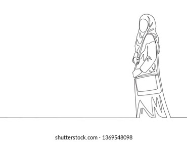 One continuous line drawing of young pretty muslimah on Islamic cloth carrying purse and ready to hangout. Beauty Asian woman model in trendy hijab fashion concept single line draw design illustration