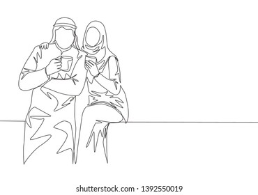 One continuous line drawing of young muslim and muslimah couple pose romantic together while holding a cup of coffee. Islamic clothing shmagh, kandura, scarf. Single line draw design illustration