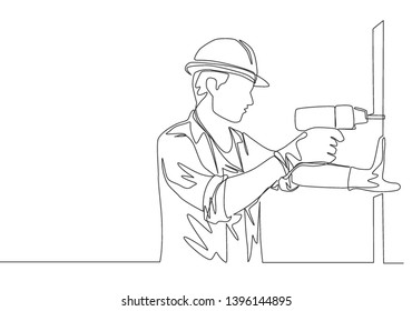 One continuous line drawing of young handsome handyman drilling wooden wall using drill machine. House maintenance service concept single line draw design illustration