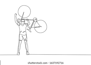 One continuous line drawing of young sporty man bicycle racer lift his bicycle up to celebrate winning. Road cyclist concept. Single line draw design vector illustration for cycling competition poster