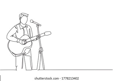 One continuous line drawing of young happy male guitarist playing acoustic guitar and singing on music festival stage. Musician artist performance concept single line draw design vector illustration