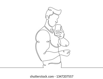One continuous single drawn line art doodle athlete bodybuilder fitness relieves himself on  phone .Guy athlete makes selfie . Isolated image  hand drawn outline  white background.Gym, sports concept.