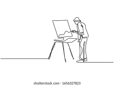 One line drawing of painter artist. A man standing painting an artwork on canvas. Continuous han drawn minimalism.