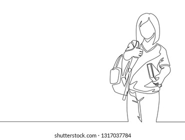 One line drawing of young beauty elementary school girl student. Education concept continuous line draw design