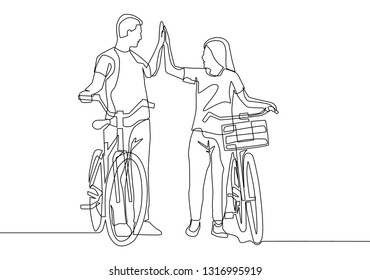 One line drawing of young happy couple take a walk with bicycle. Relationship concept continuous line draw design illustration