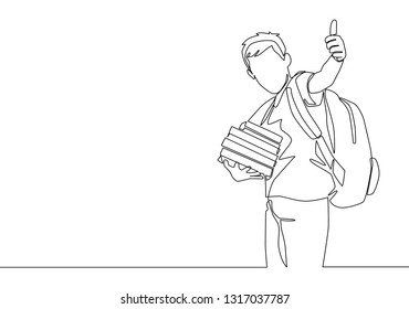 One line drawing of young happy elementary school boy student carrying stack of books and giving thumbs up gesture. Education concept continuous line draw design