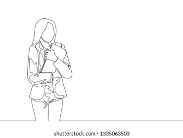 One single line drawing of young female worker tightly hugging the file she was carrying. Work depression concept continuous line draw design illustration
