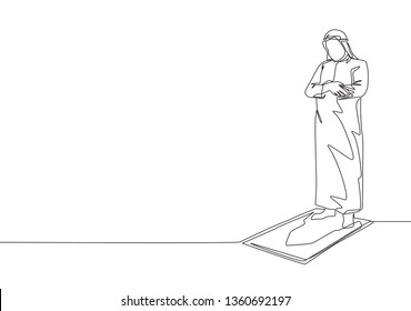One single line drawing of young muslim person pray salat on sajadah in shmag traditional Arab cloth. Ramadan Kareem and Eid Mubarak greeting card concept continuous line draw design illustration