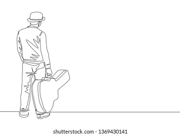 One single line drawing of young happy male guitarist standing and holding acoustic guitar case. Musician artist concept continuous line draw design illustration