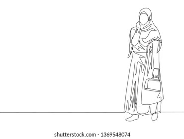 One single line drawing of young happy muslimah bringing little bag and ready to go shopping. Beauty Asian woman model in trendy hijab fashion concept continuous line draw design illustration