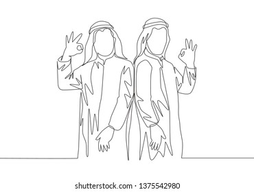 One single line drawing of young happy muslim employees give OK alright hands gesture. Saudi Arabian businessmen with shmag, kandora, headscarf, thobe, ghutra. Continuous line draw design illustration