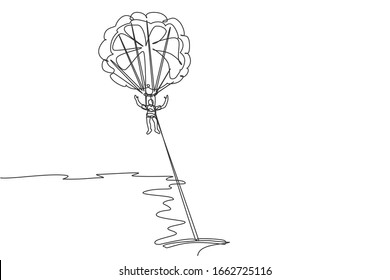 One single line drawing of young sporty man flying with parasailing parachute on the sky pulled by boat graphic vector illustration. Extreme sport concept. Modern continuous line draw design