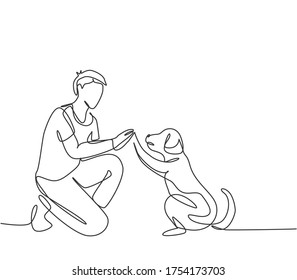 One single line drawing of young happy boy giving high five gesture to his puppy dog at outfield park. Pet care and friendship concept. Continuous line draw graphic design vector illustration